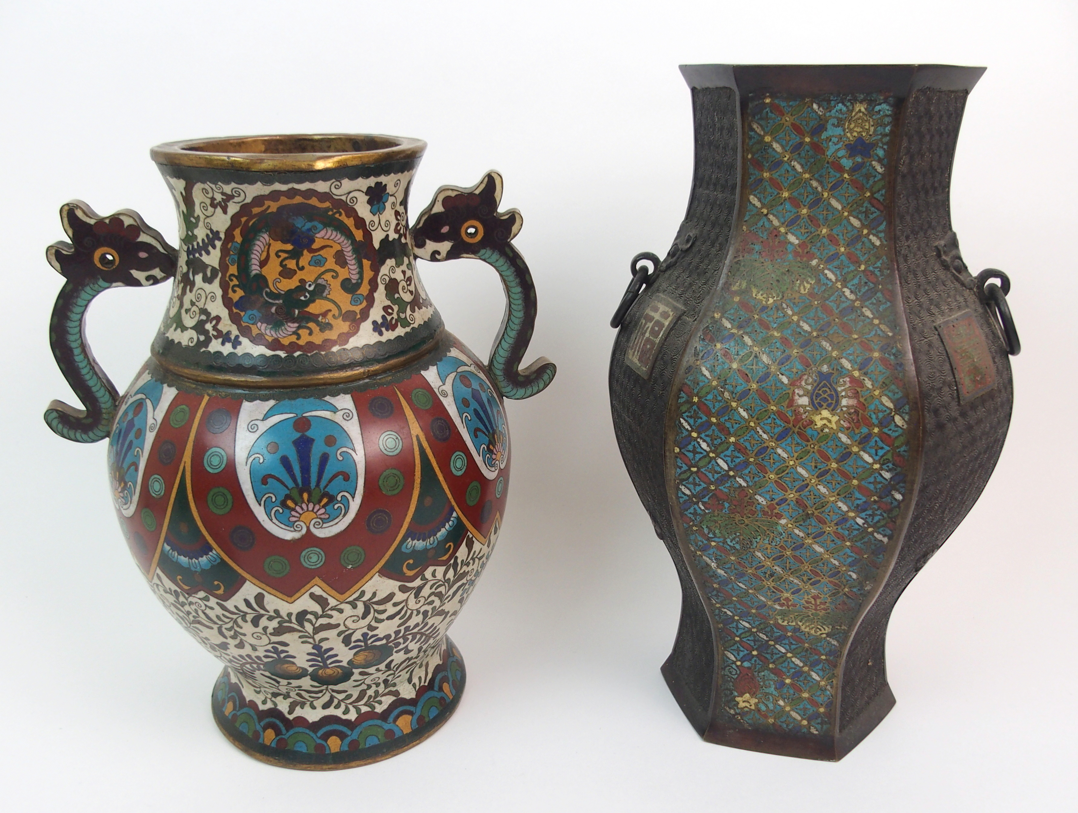 Lot 4 - A CHINESE CLOISONNE TWO-HANDLED VASE decorated with medallions of dragons, still leaf lappets and