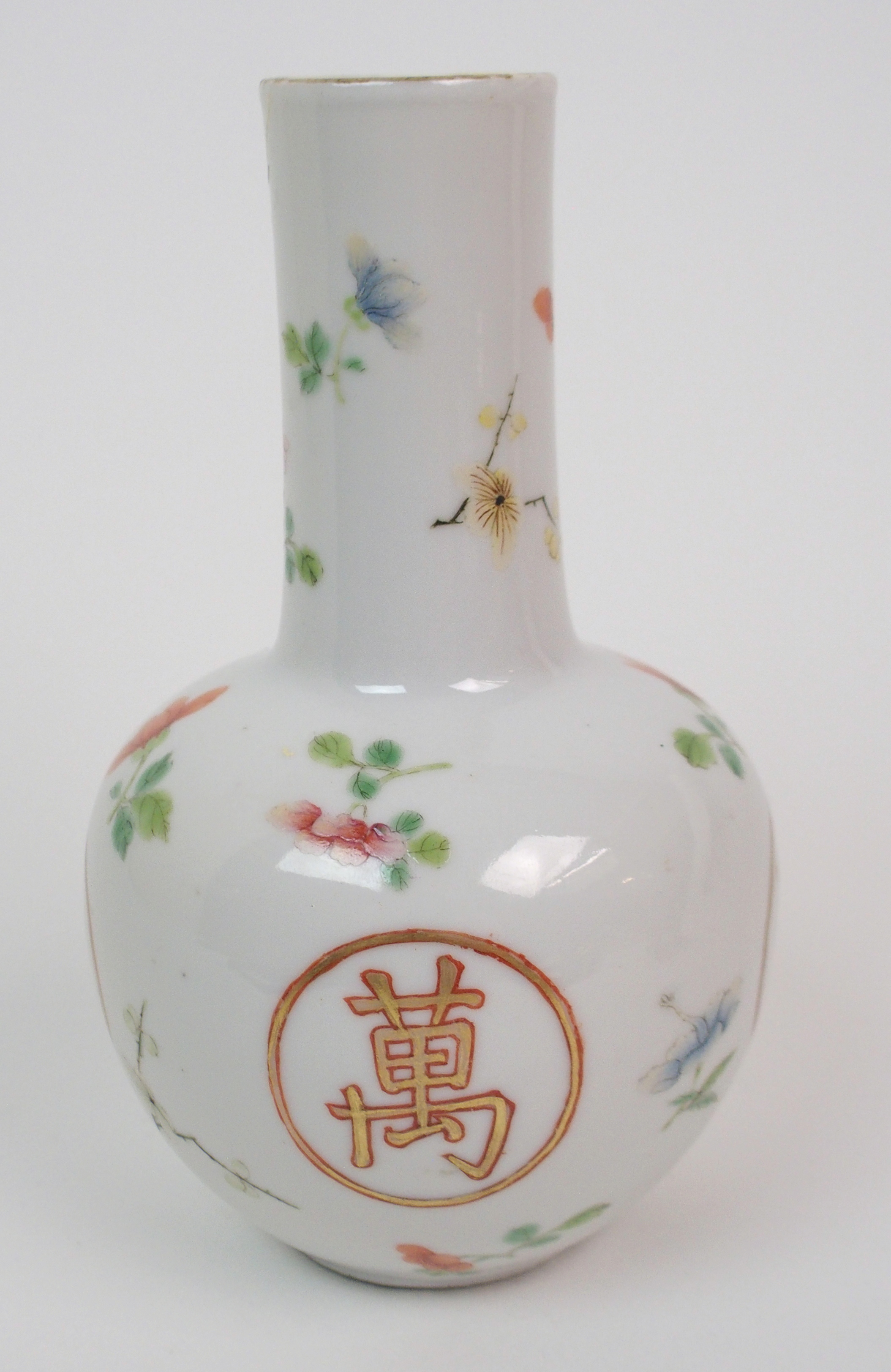Lot 30 - A CHINESE BALUSTER VASE painted with gilt shou character roundels amongst scattered flowers, red