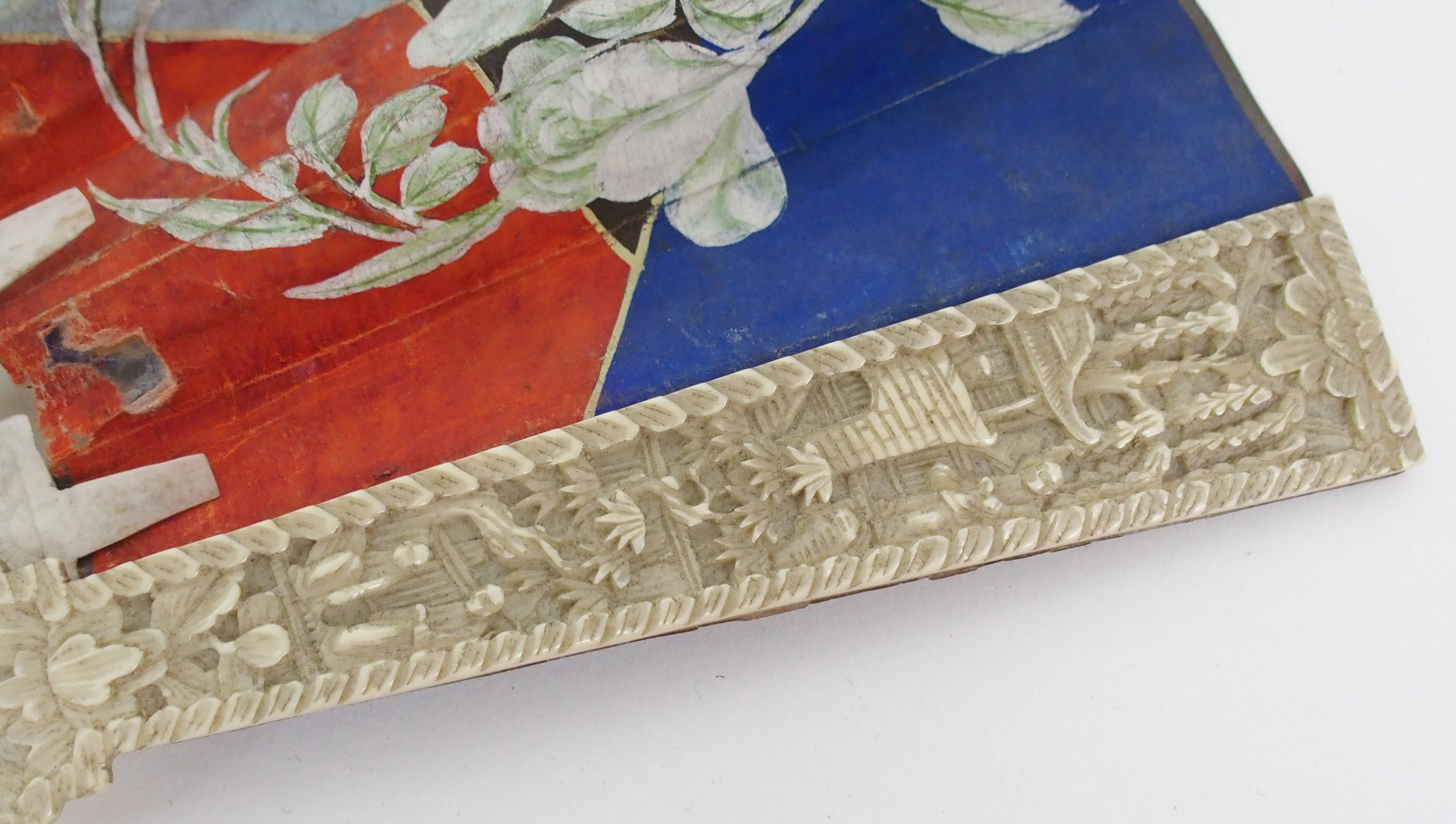 Lot 11 - A PAIR OF LACQUERED AND ONLAID PANELS decorated in ivory and abalone shell with male and female