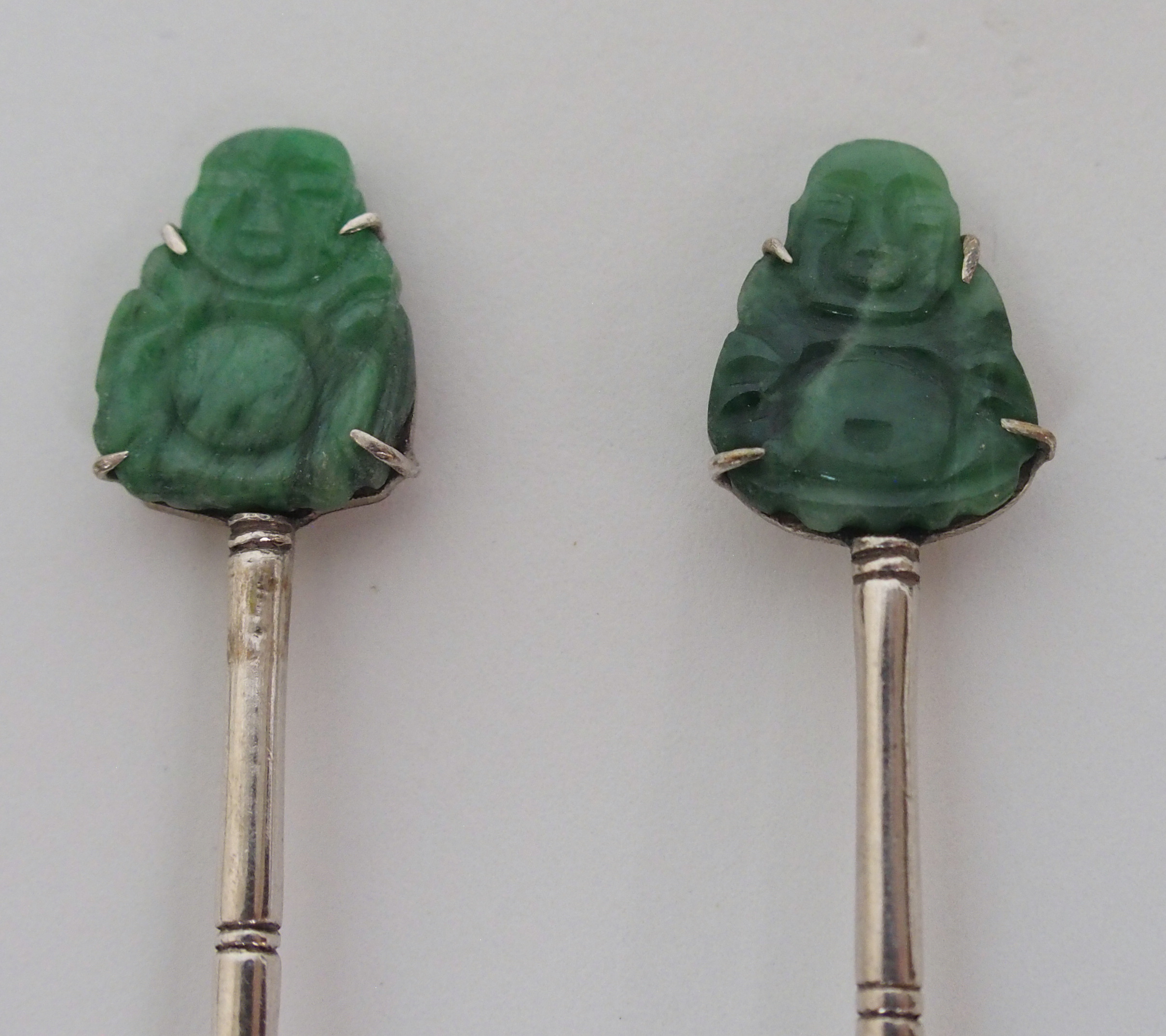 Lot 8 - A SET OF SIX CHINESE SILVER TEASPOONS each set with a hardstone carving of Buddha, stamped Tack