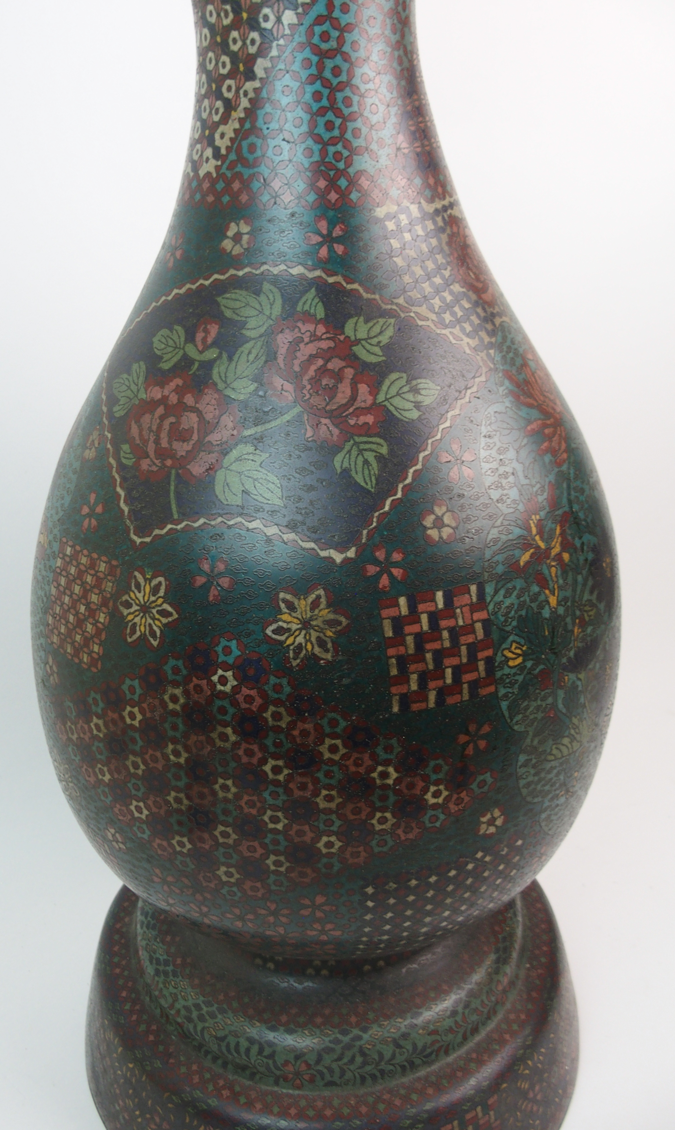 Lot 1 - A CHINESE CLOISONNE BALUSTER VASE decorated with panels of flowers and diaper raised on a tripod