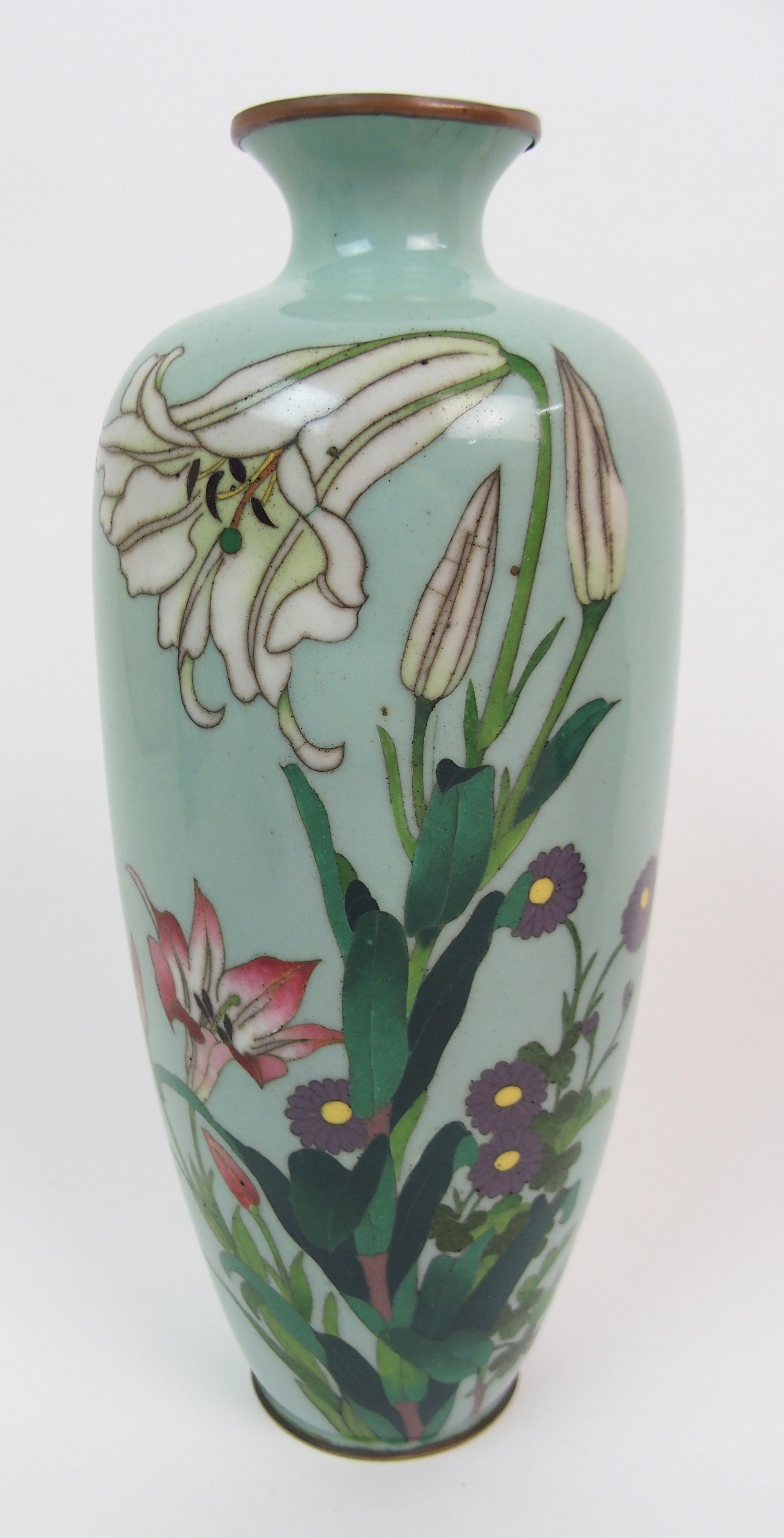Lot 3 - A CHINESE CLOISONNE CERAMIC JAR AND COVER decorated with flowers and butterflies beneath a foliate