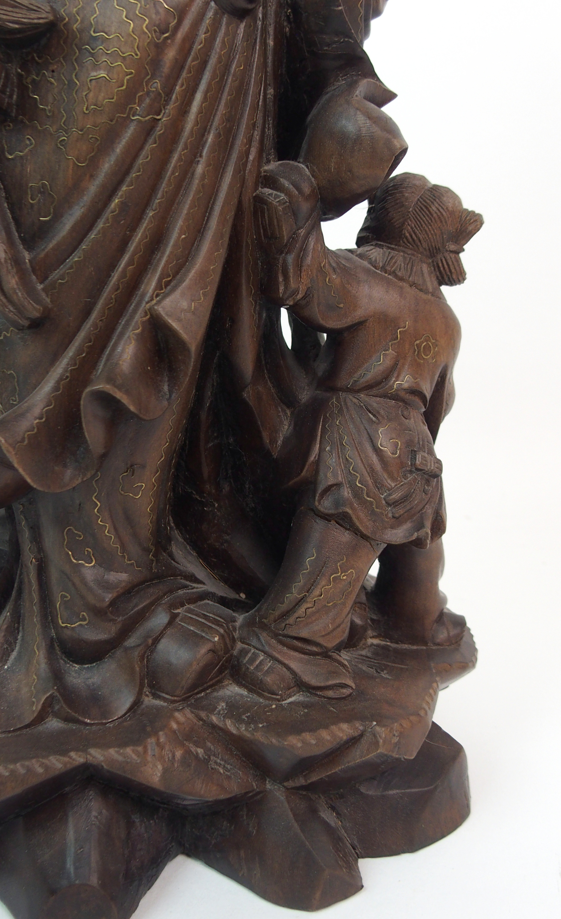 Lot 54 - A HARDWOOD CARVING OF A SAGE AND ATTENDANTS standing with staff, fruit and deer at his feet on a