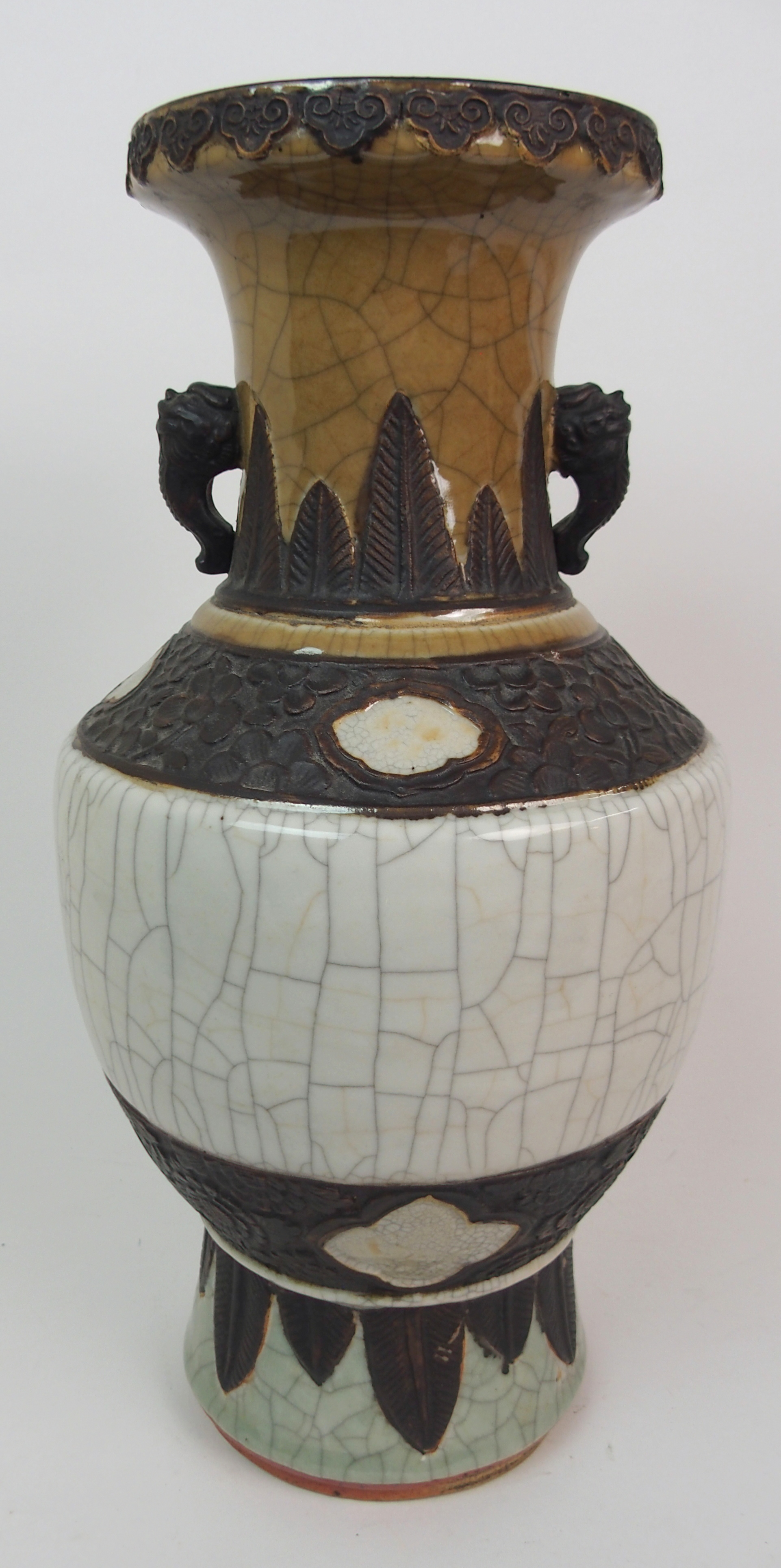 Lot 28 - A CHINESE CRACKLEWARE THREE COLOUR VASE with grotesque handles and bands of foliage within stiff