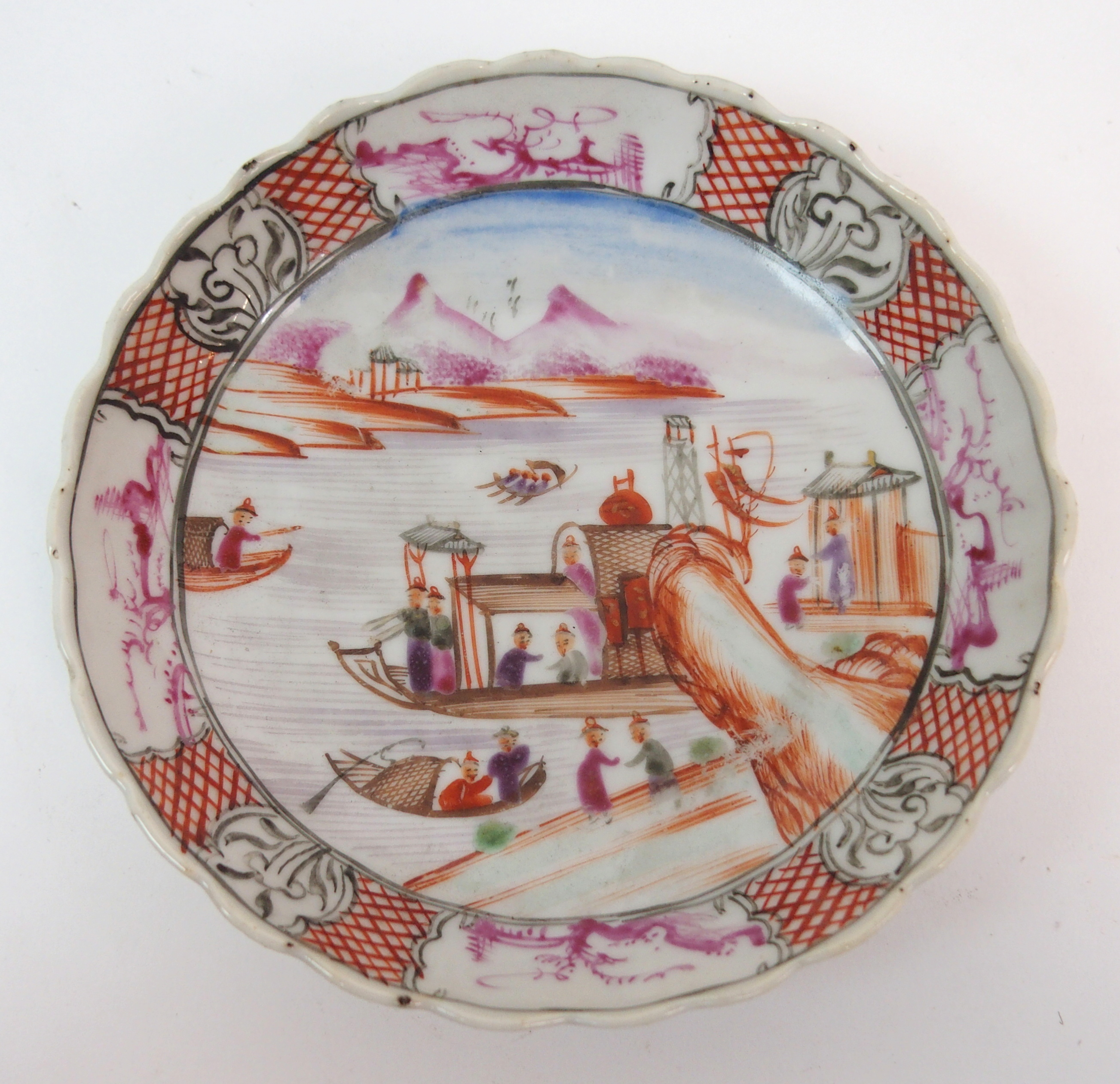 Lot 43 - A CHINESE EXPORT SOUP PLATE painted with figures beside a pavilion within a border of landscape