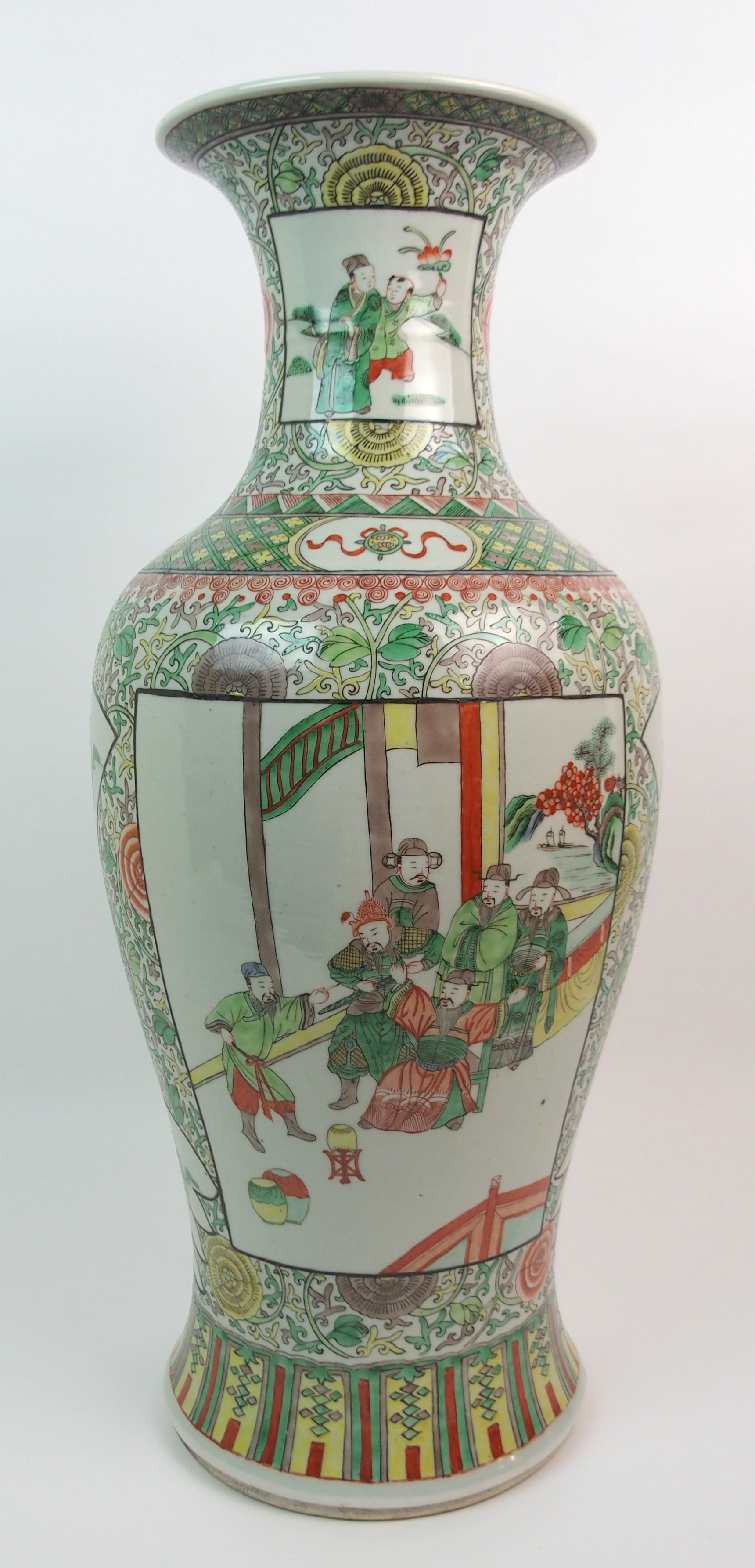 A CHINESE FAMILLE VERTE LARGE BALUSTER VASE painted with panels of figures surrounded by flowers and
