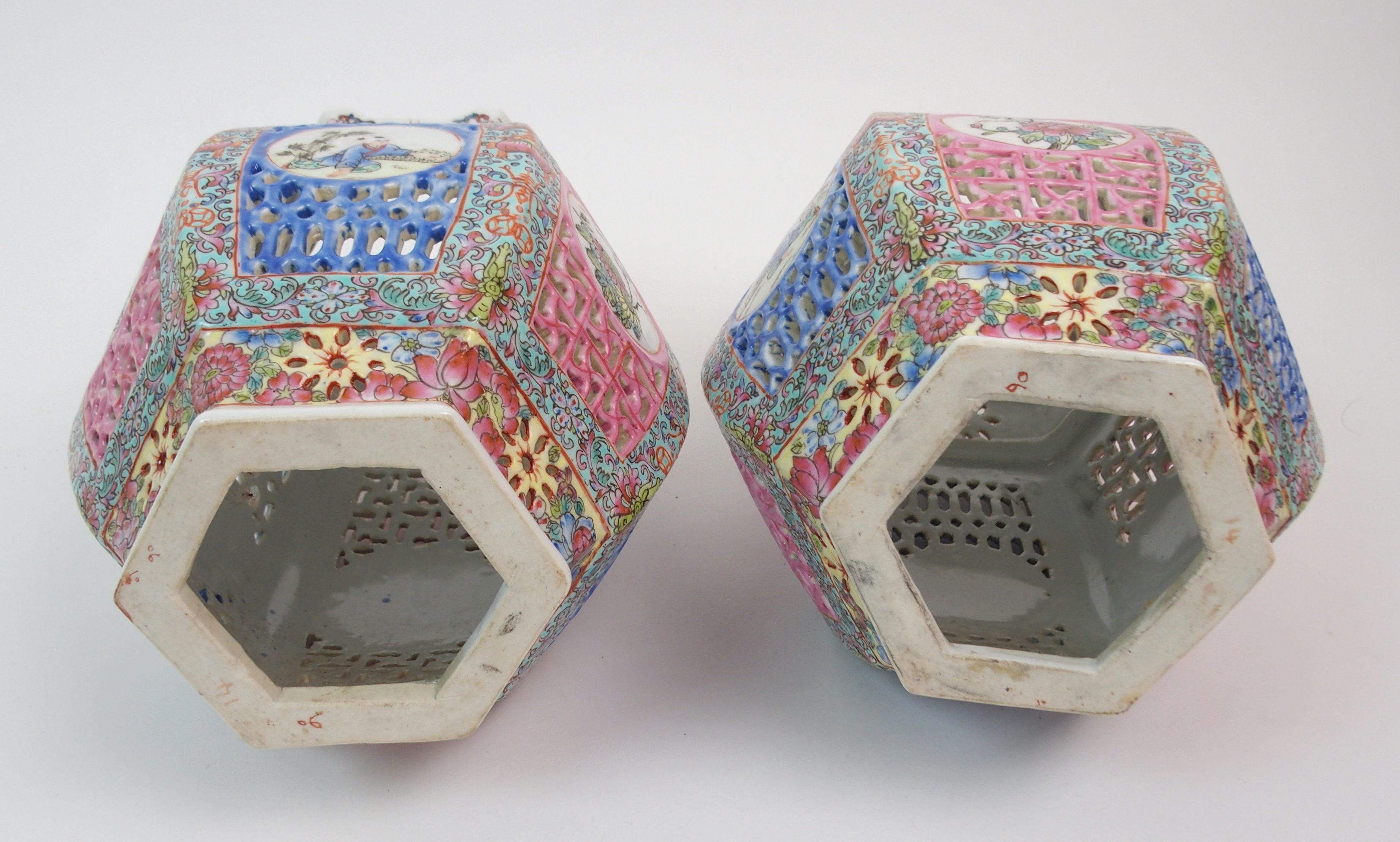 Lot 12 - A PAIR OF CHINESE POLYCHROME HEXAGONAL LANTERN VASES painted and pierced with alternate panels of