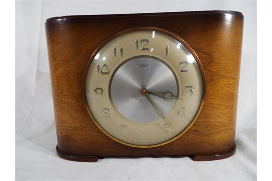 A 'Time Savings' mantel clock, coin operated/ wound