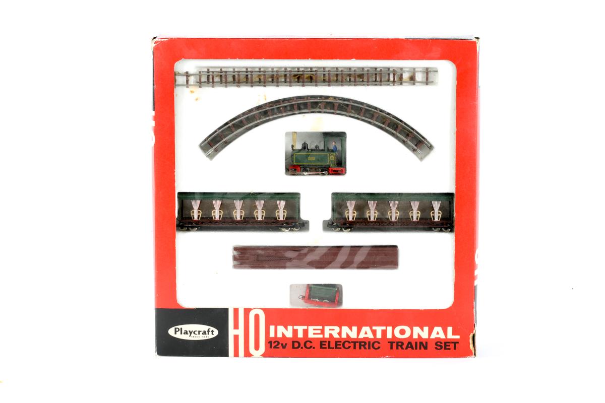 Lot 2 - A Playcraft HO gauge electric train set (P1610). Comprising narrow gauge locomotive, 2x passenger