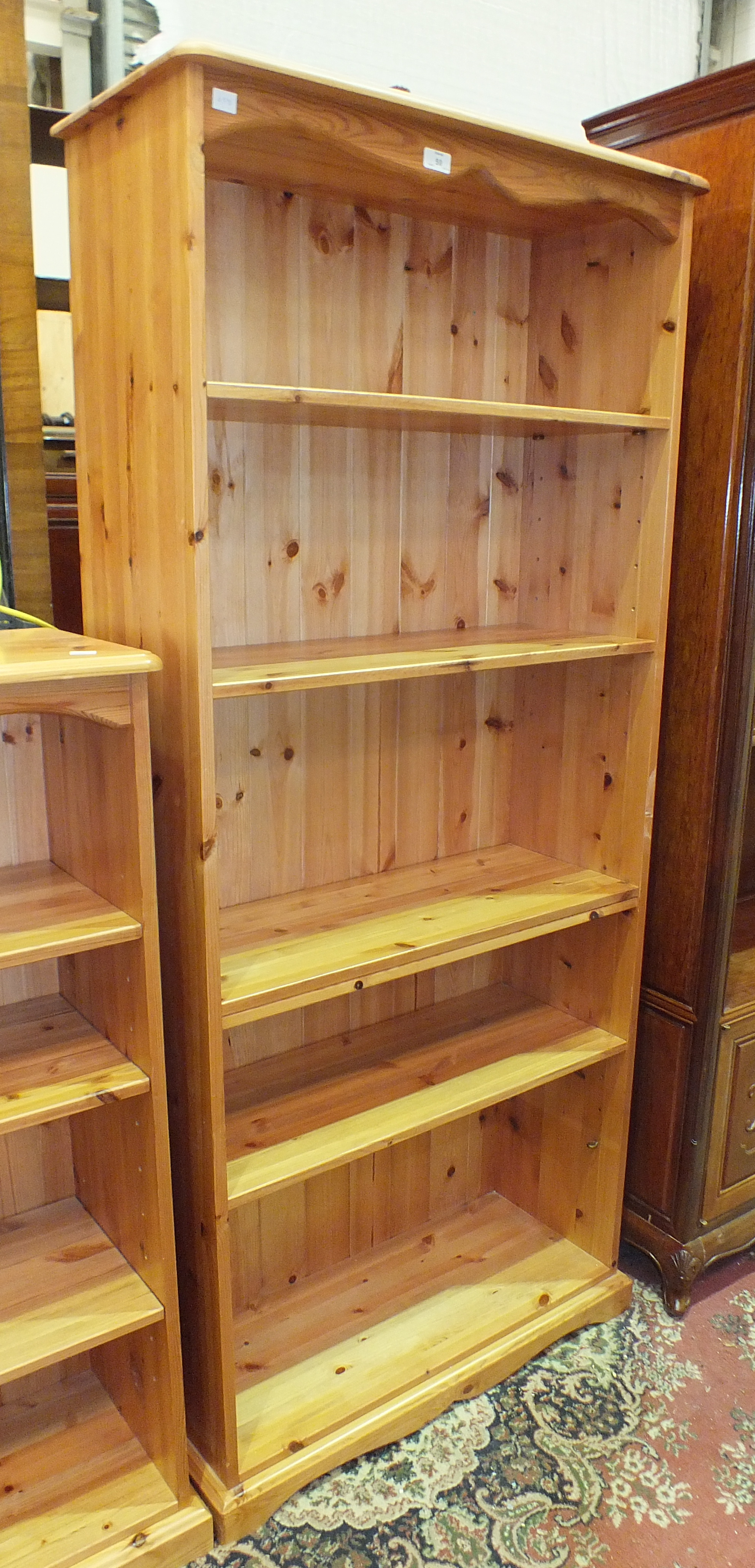 A set of modern pine open shelves, 80cm wide, 183cm high and a similar smaller set, 80cm wide, 120cm