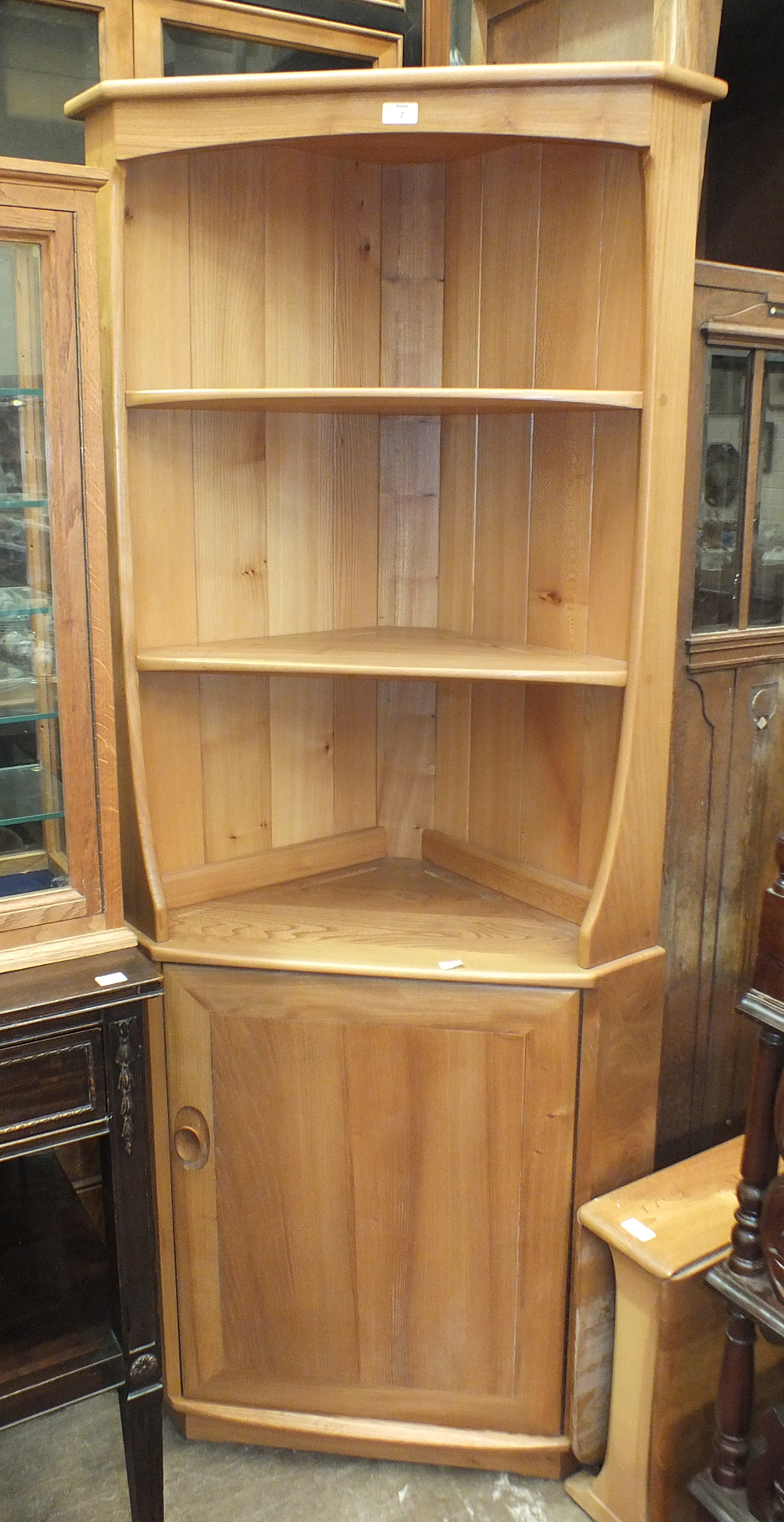An Ercol light wood corner shelf unit/cabinet, 76cm wide, 179cm high and a small Ercol-style drop-