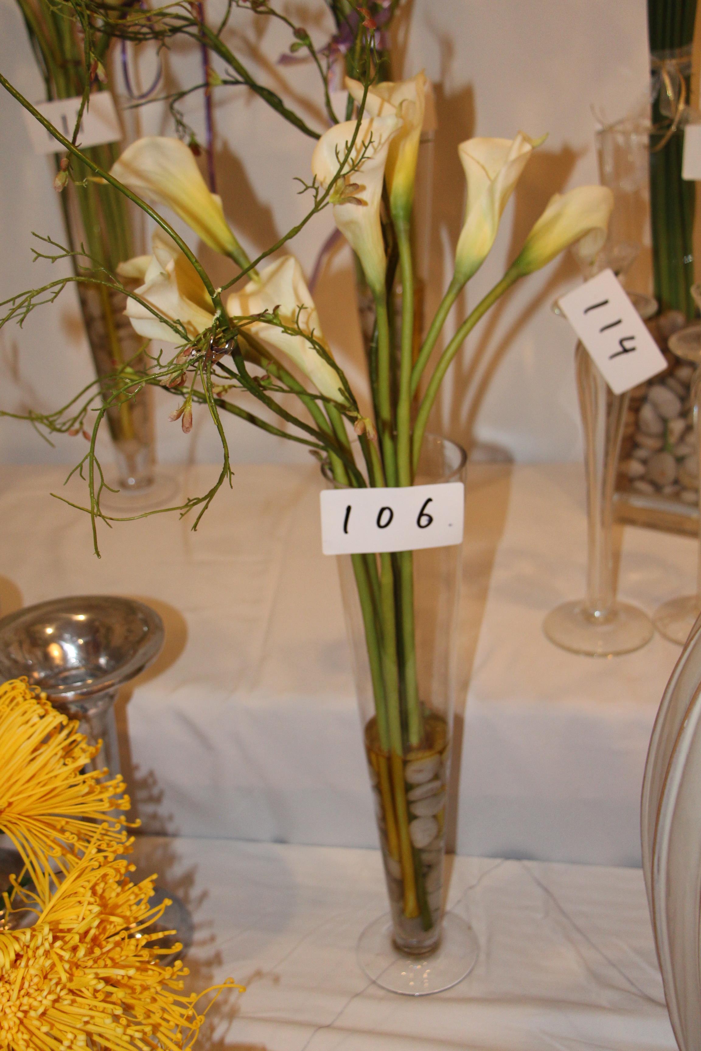 Lot 106 - Faux flower arrangement w/ glass vase