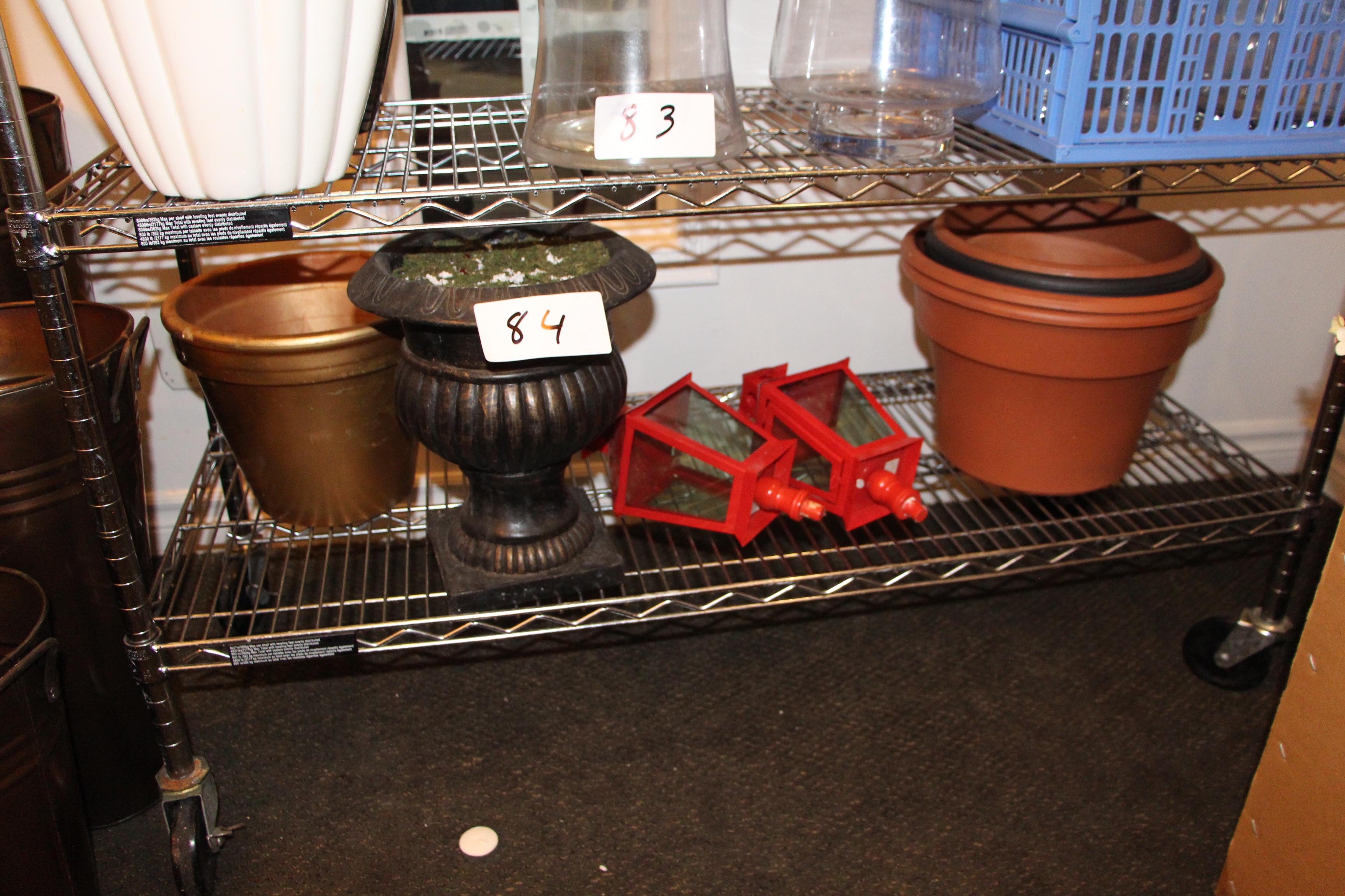 Lot 84 - Lot assorted flower pots and lanterns on shelf