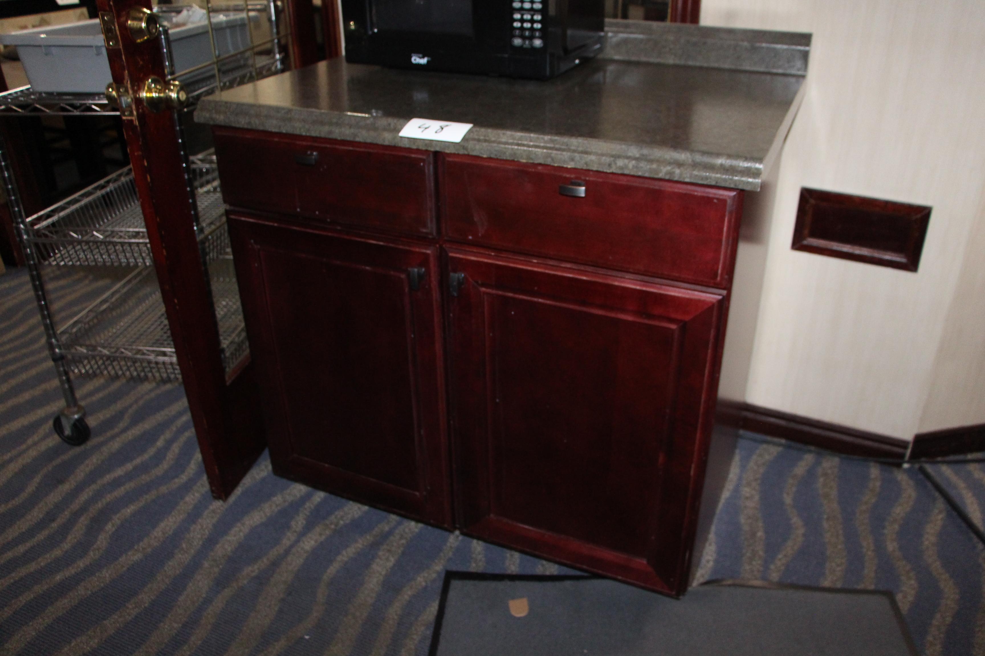 Lot 48 - Wooden 2 door 2 drawer cabinet w/ laminate countertop
