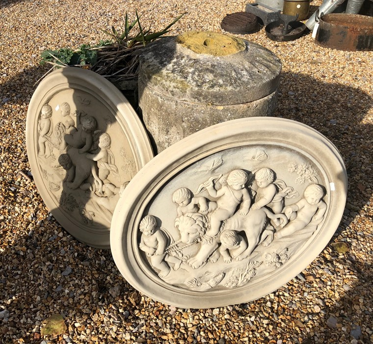 Lot 28A - Two oval garden plaques decorated, each in relief with a lion and putti (2)