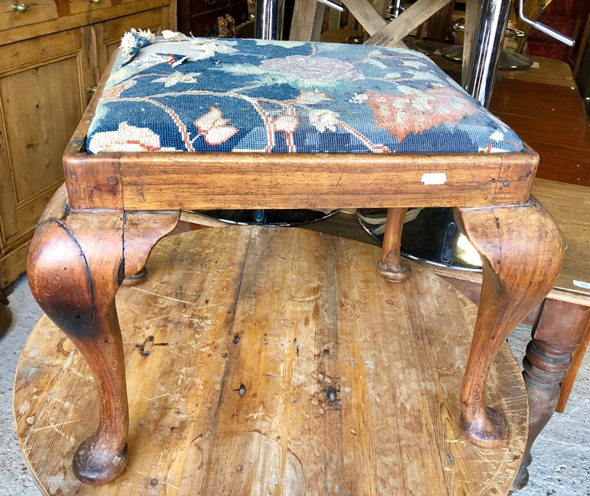 Lot 54 - 19th century walnut stool with cabriole legs and distressed needlepoint seat