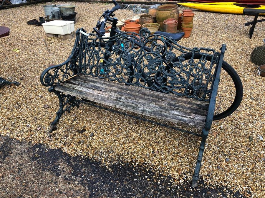 Lot 20 - A cast iron Colebrookdale style garden bench with wood slat seat