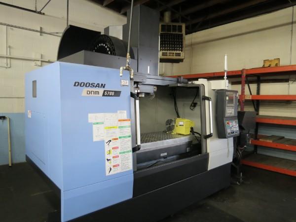 Lot 52 - Doosan DNM 5700 4-Axis Vertical Machining Center, Fanuc control, 12K rpm, 30 Tools, New 2017