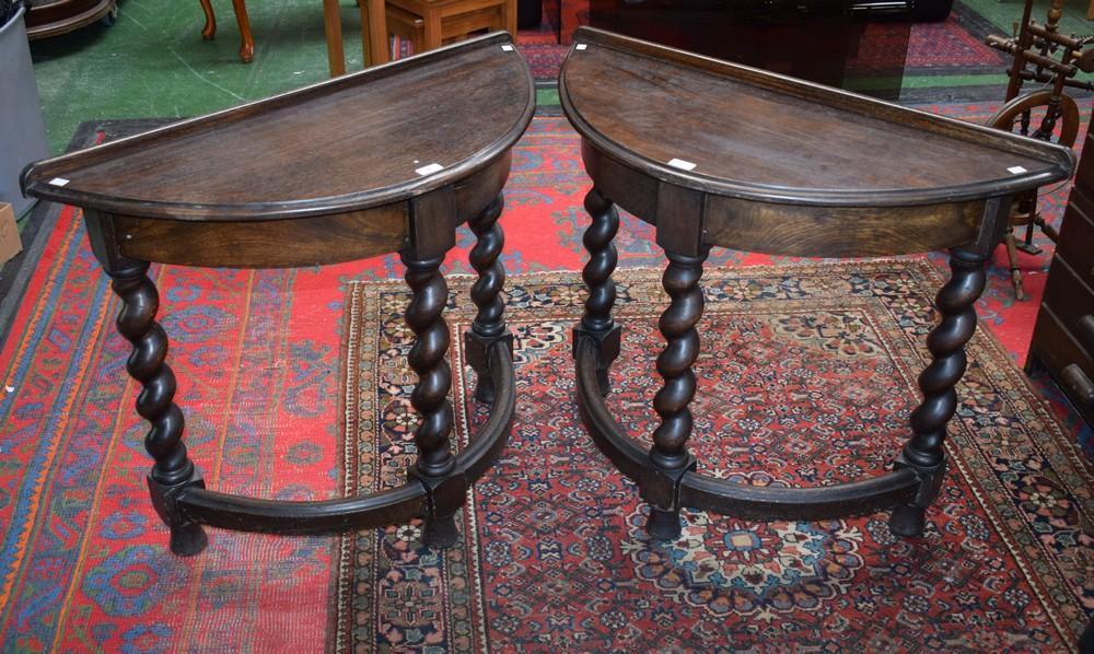 Lot 6 - A pair of Jacobean Revival oak demi-lune side/console tables,