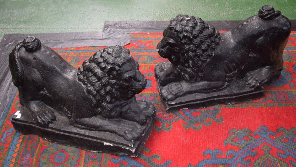 Lot 7 - A pair of black painted reconstituted garden lions,