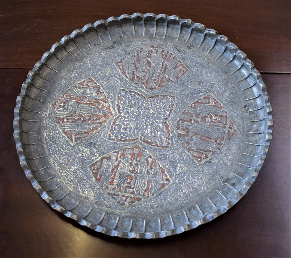 Lot 46 - A Middle Eastern shaped circular tinned charger,