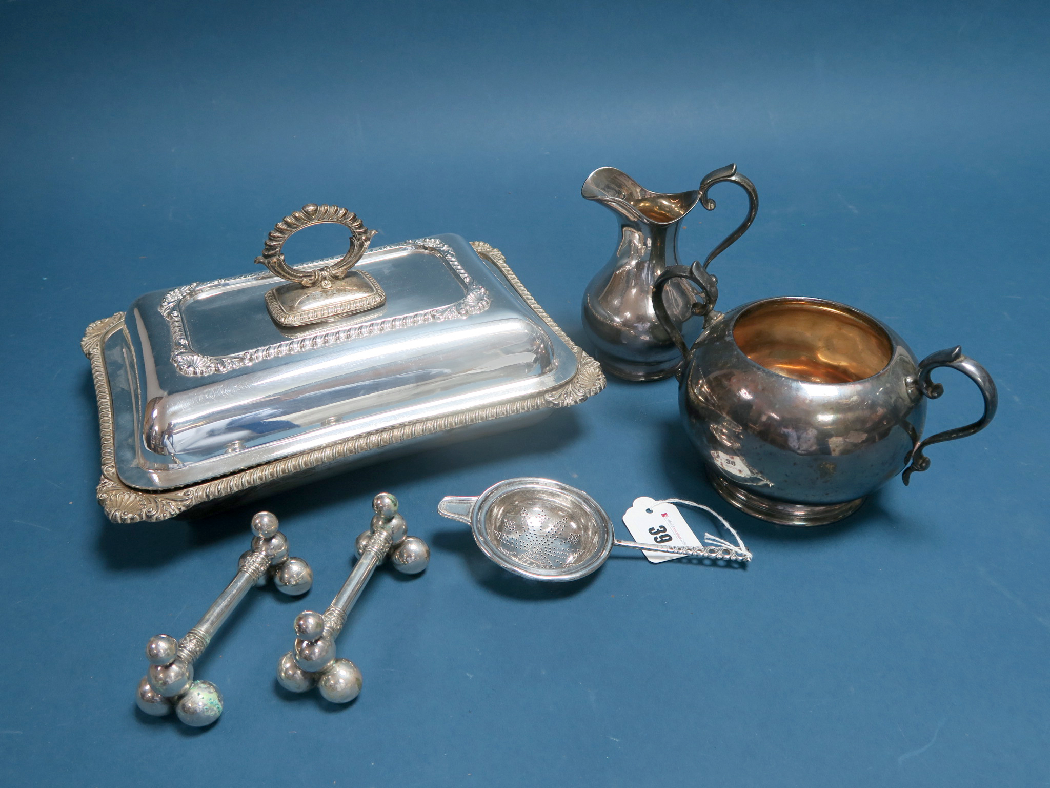 Lot 39 - A Hallmarked Silver Tea Strainer, HA, Sheffield 1901, with pierced handle, together with a pair of