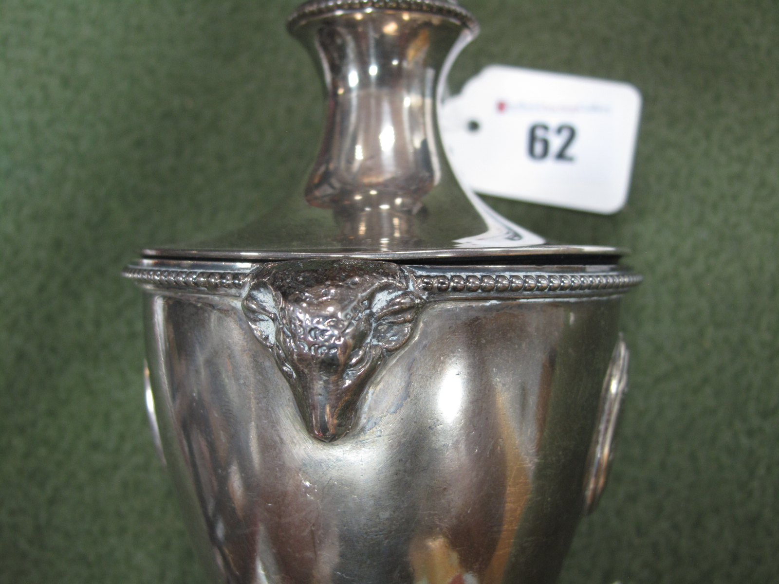 Lot 62 - A Hallmarked Silver Urn and Cover, JES, Sheffield 1893, with twin rams masks and oval cameo style