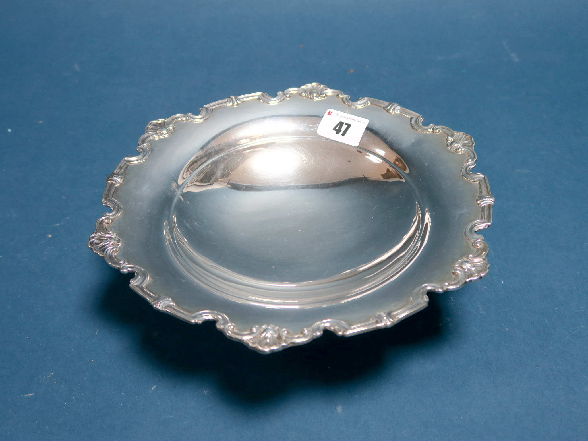 Lot 47 - A Hallmarked Silver Dish, Mappin & Webb, Sheffield 1944, of shaped circular design, raised on
