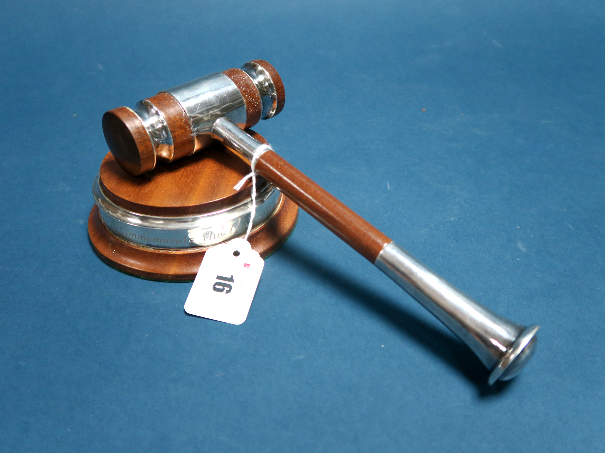 Lot 16 - A Hallmarked Silver Mounted Gavel, CCA, Sheffield 1978; Together with Block, of circular form, the