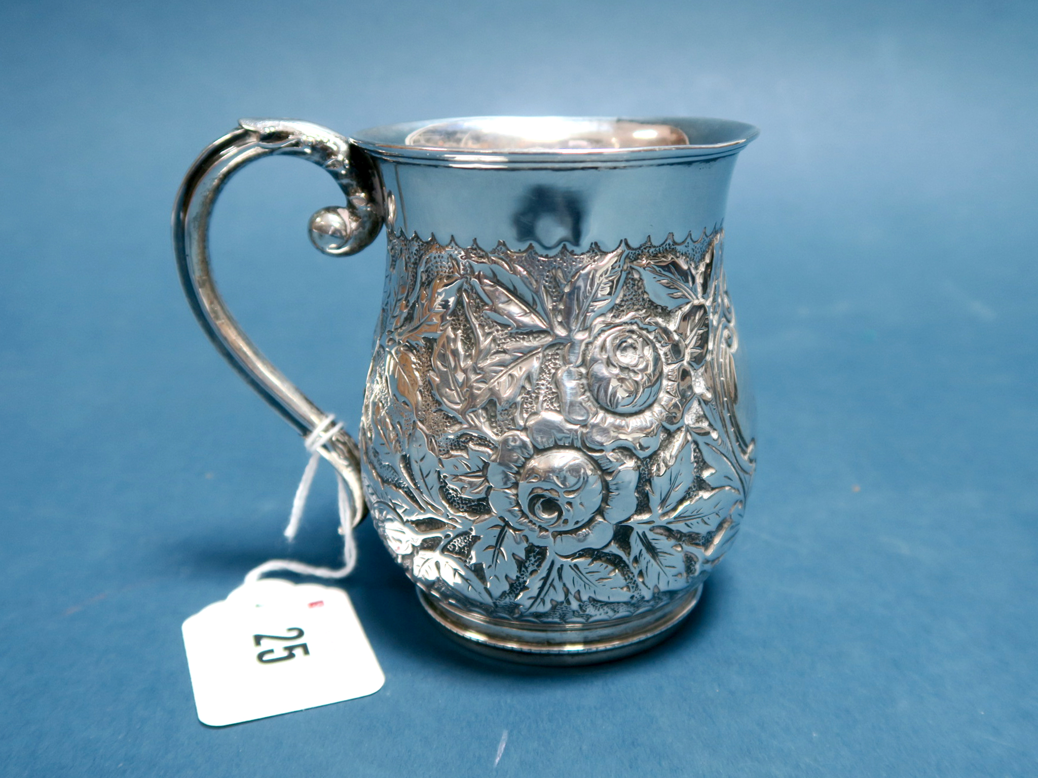 Lot 25 - A Hallmarked Silver Mug, (makes mark rubbed) Birmingham 1894, of baluster form allover detailed in
