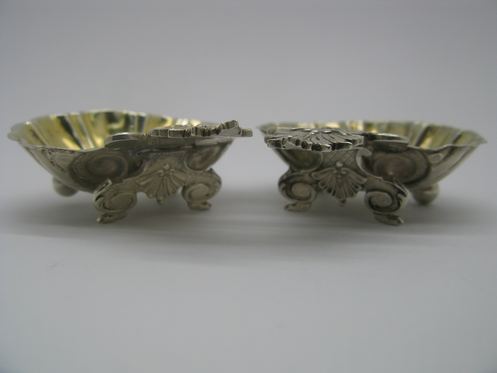 Lot 13 - Gustav Marmuse; A Pair of Highly Decorative French Salts, the gilt lined shell bowls with applied