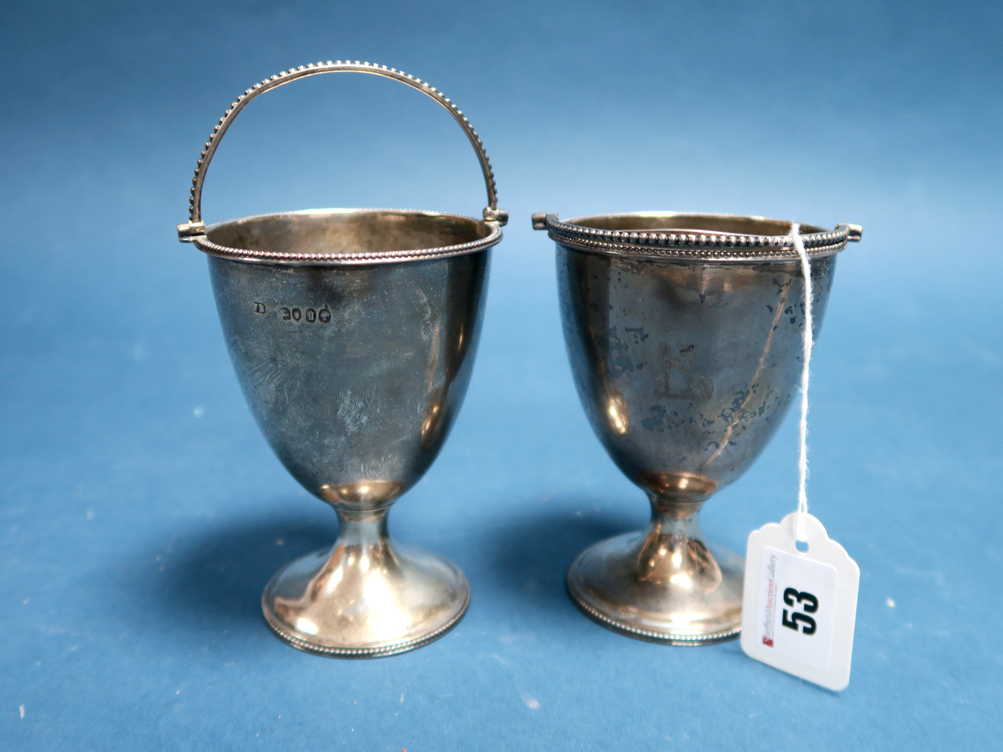 Lot 53 - A Pair of Victorian Hallmarked Silver Sugar Baskets, F.B, London 1862, each of plain tapering
