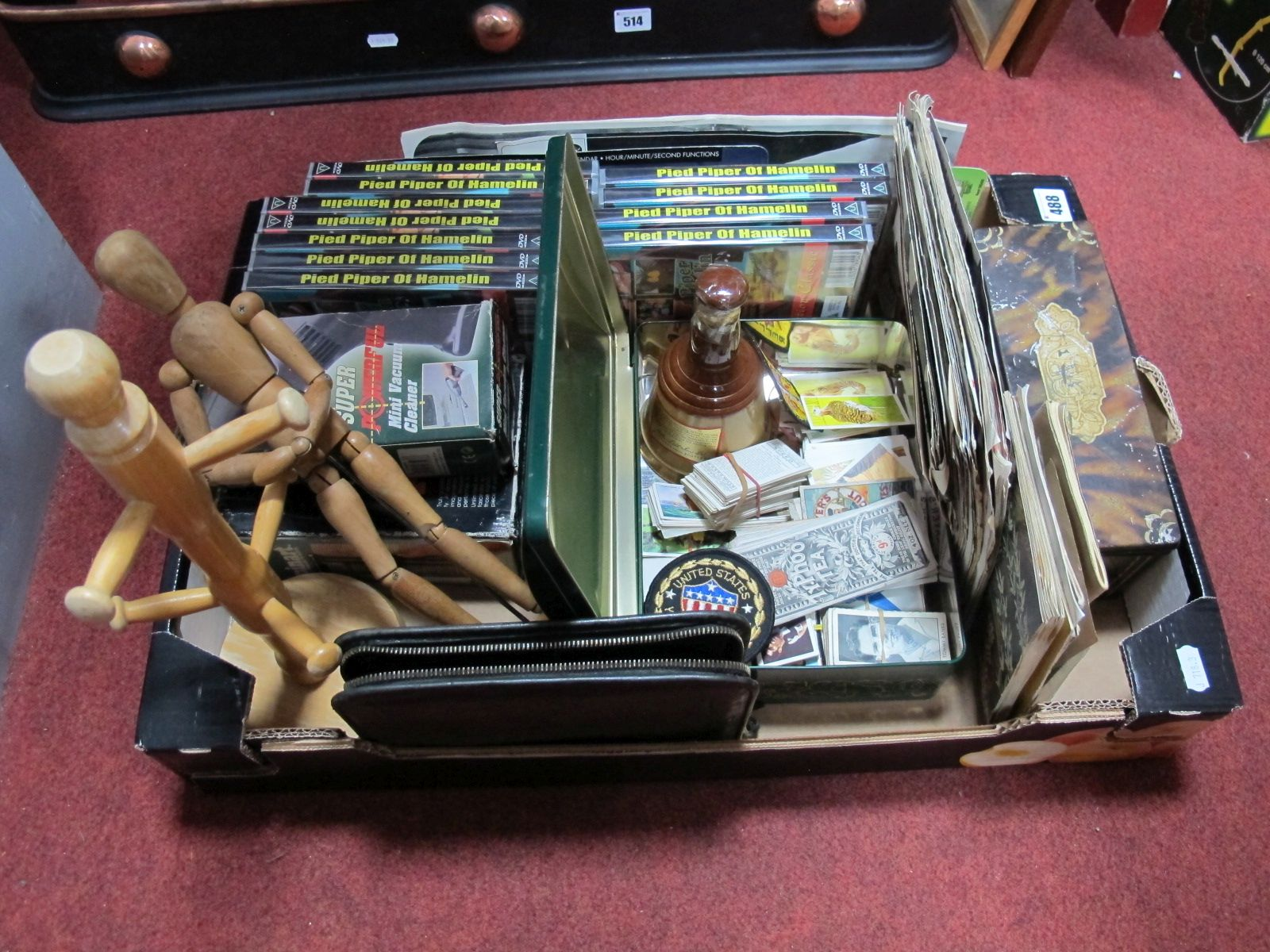 "Lot 488 - A 12"" Wooden Artist's Mannequin, DVD's, knitting patterns, trade cards, musical compact, etc:- One"