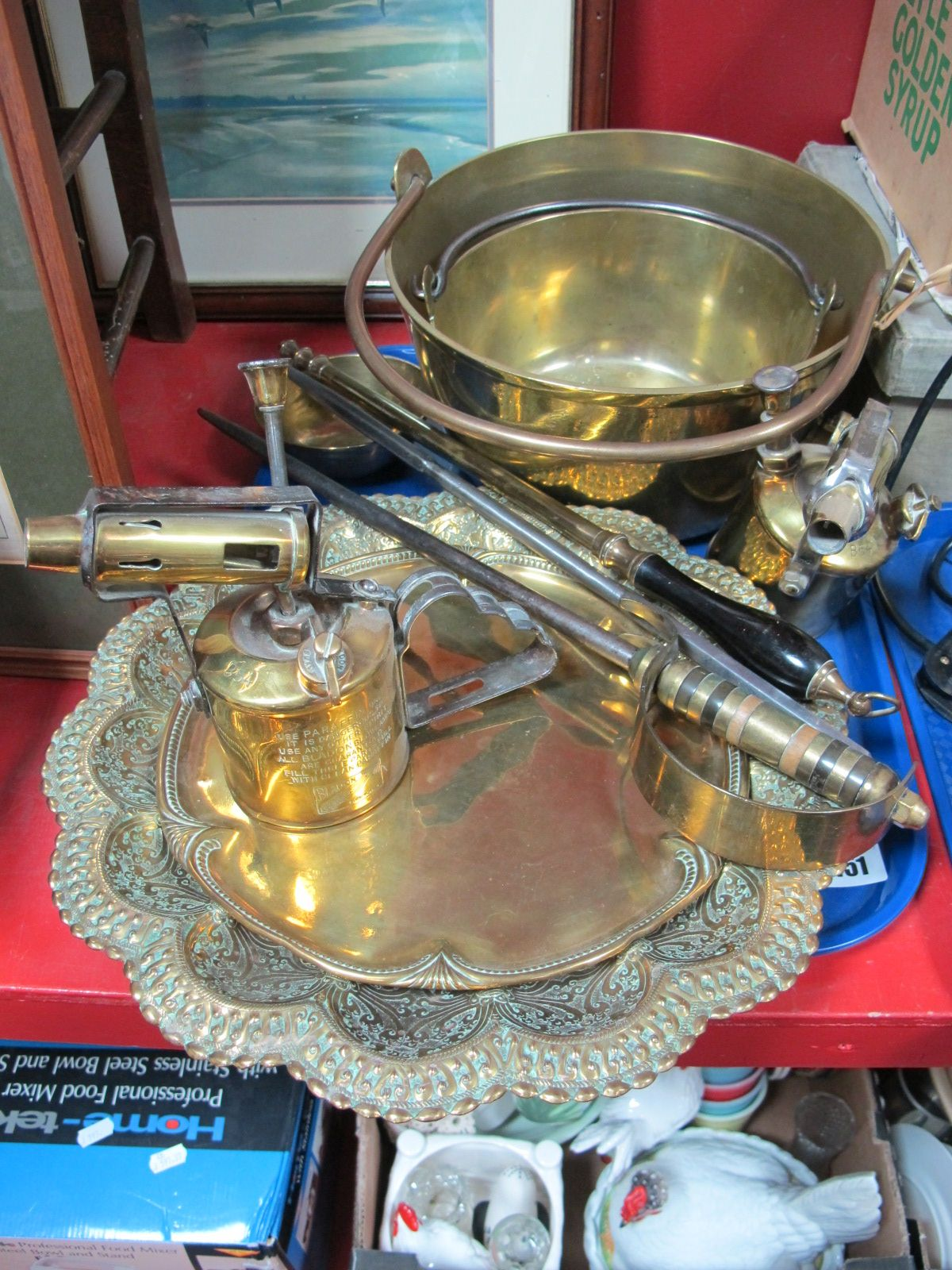 Lot 451 - Two XIX Century Brass Jam Pans, with swing handles, two Bladon blow lamps, pokers, dishes:- One Box