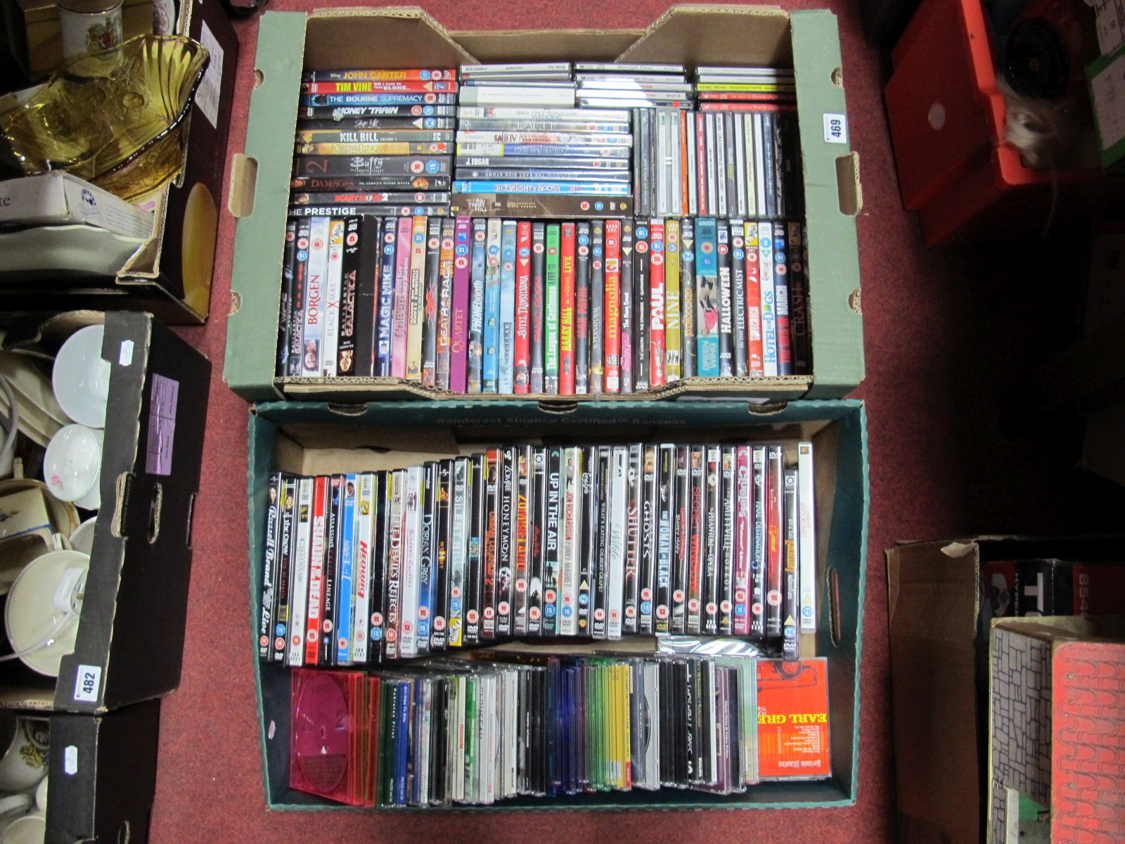 Lot 469 - A Quantity of DVD and CD's, modern titles noted, (over ninety):- Two Boxes