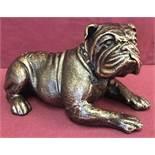 A bronzed cast iron figurine of a Bulldog dog.
