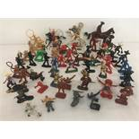 A collection of 64 plastic Cowboy, Indian and Mexican bandit figures.