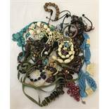 A bag of costume jewellery necklaces, bangles and bracelets.