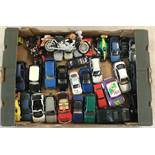A box of assorted diecast cars, racing cars and motorbikes, in various scales.