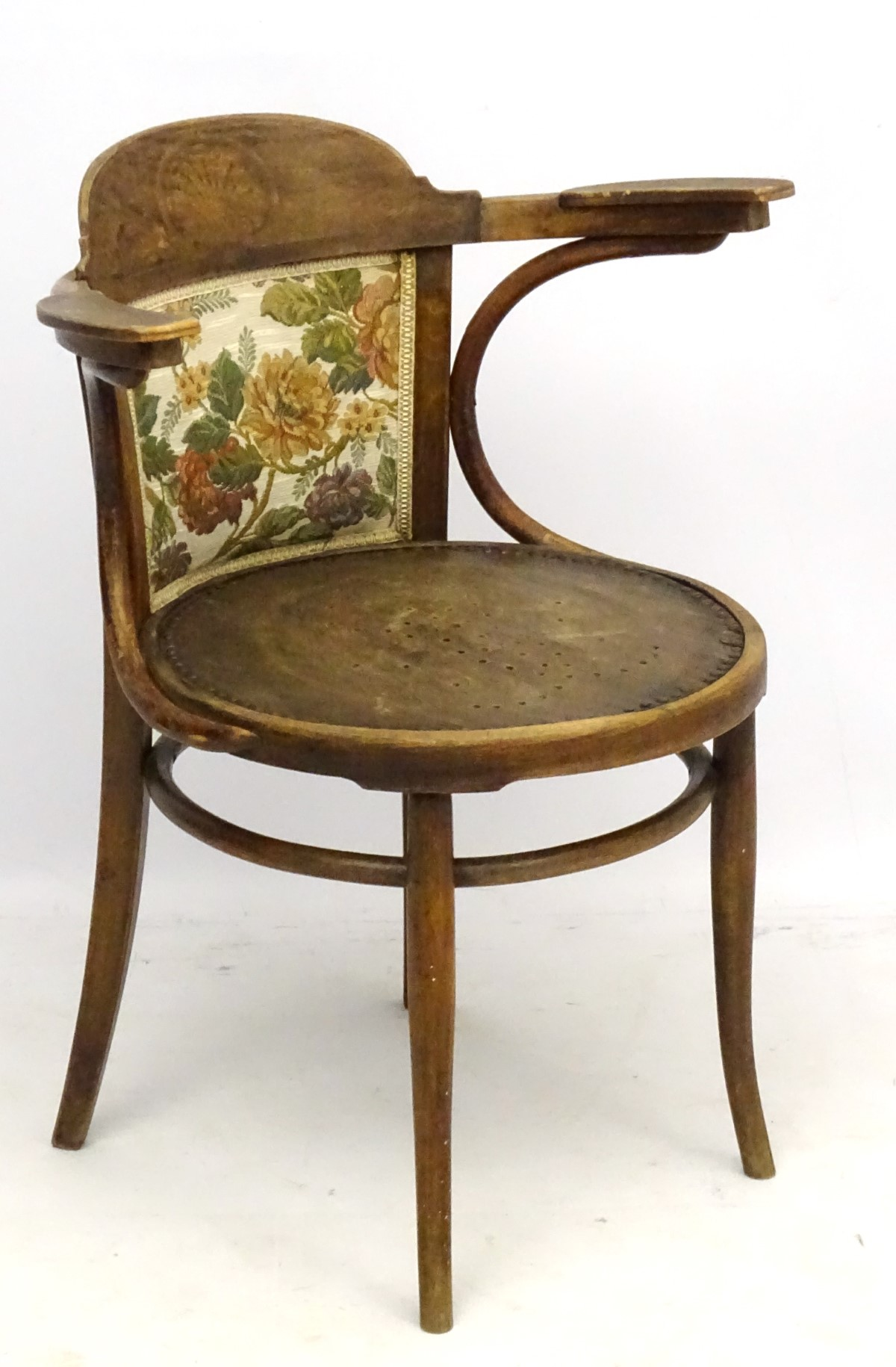 Lot 26 - An early 20thC Bentwood circular seated open arm Chair.