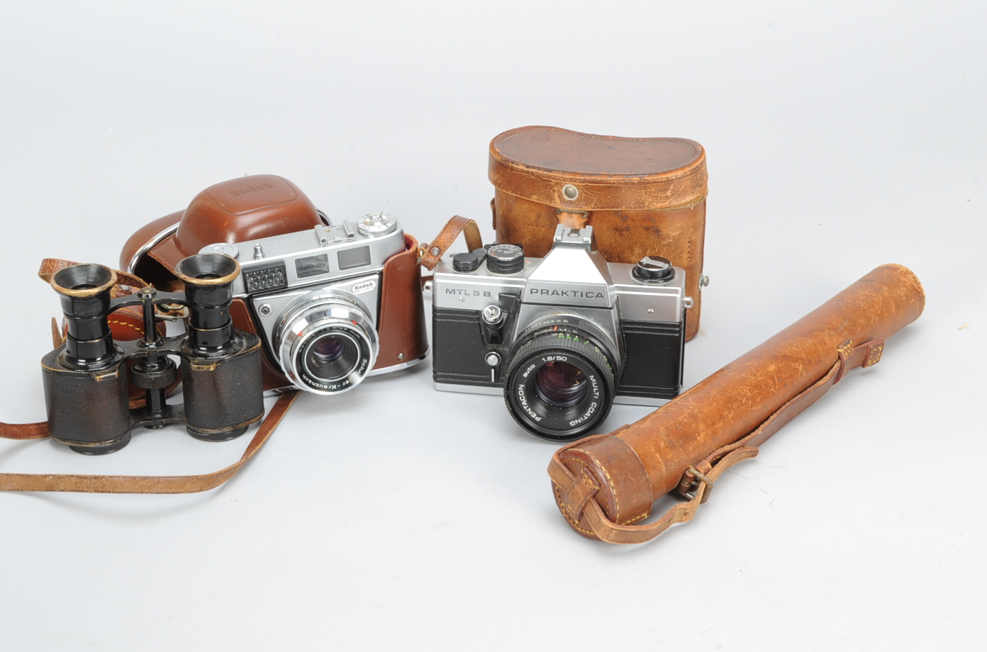 Lot 31 - Two 35mm Cameras and Accessories, a Praktica MTL 5B SLR camera, shutter working, meter untested with
