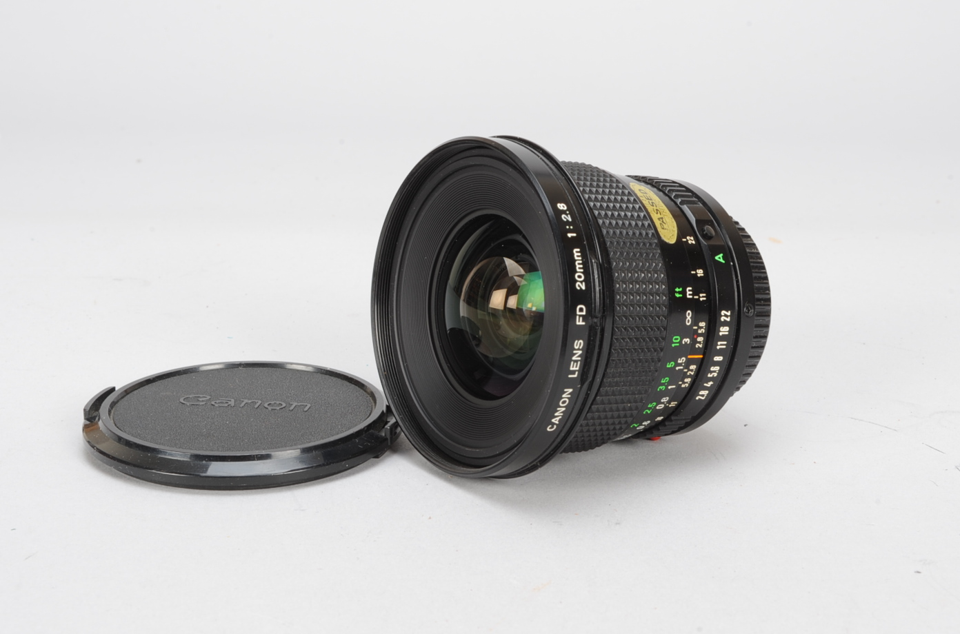 Lot 32 - A Canon FD 20mm f/2.8 Lens, serial no 26797, barrel G, elements G-VG, with front and rear caps