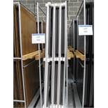 (24) Folding white timber topped tables on 3 trolleys