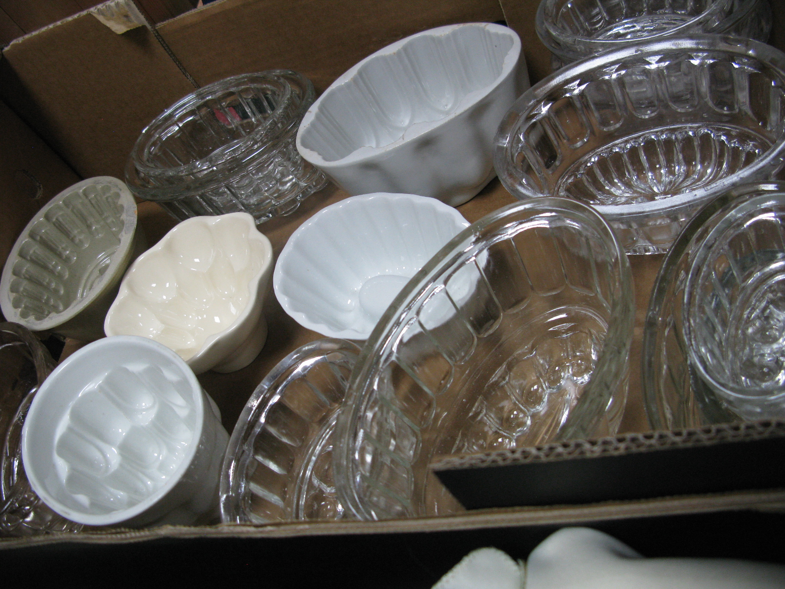 Lot 1054 - A Collection of Glass and Ceramic Moulds - One Box