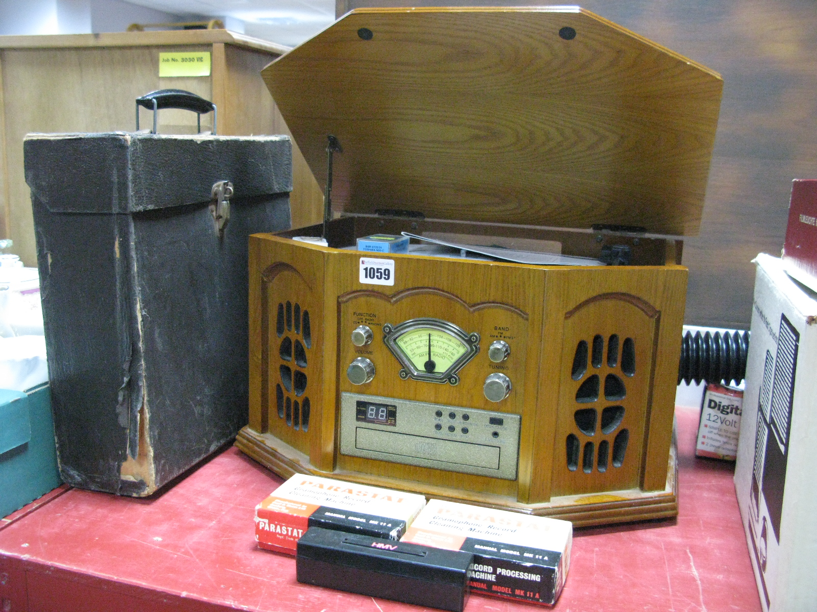 Lot 1059 - A Combination Turntable/CD/Tuner Stereo Console, in wood grain effect, and a case of 78rpm's. (2)