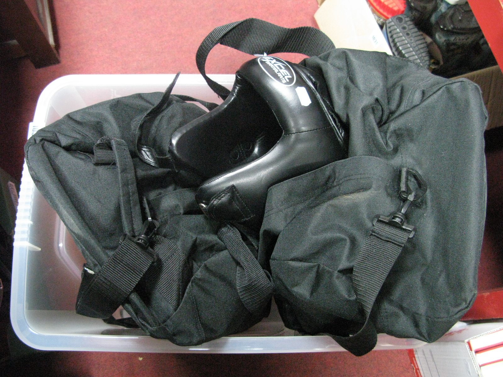 Lot 1032 - Two Soft Protective Cases of Excel Martial Arts Protection Accessories - head guards, mouth shields,