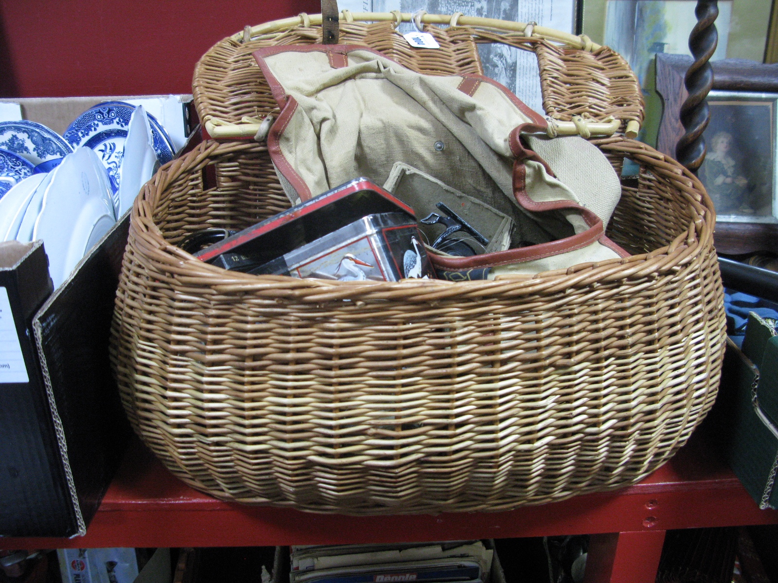 "Lot 1004 - Allcock ""Aerialite"" Fishing Reel, other fishing reels, hooks, etc, in a wicker fishing basket."
