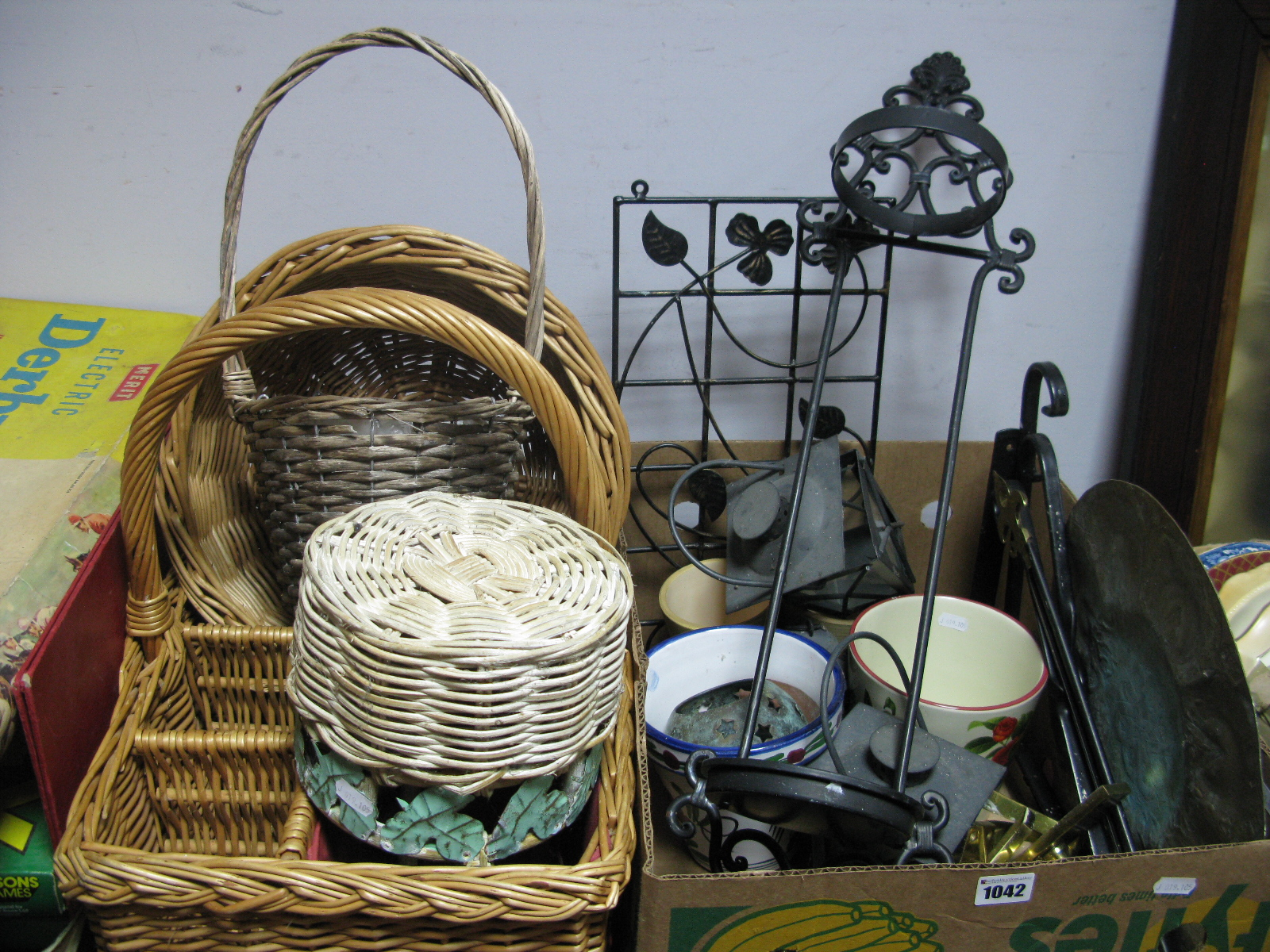 Lot 1042 - Plant Pot Holders, assorted baskets, brass door handles, brass charger, etc.