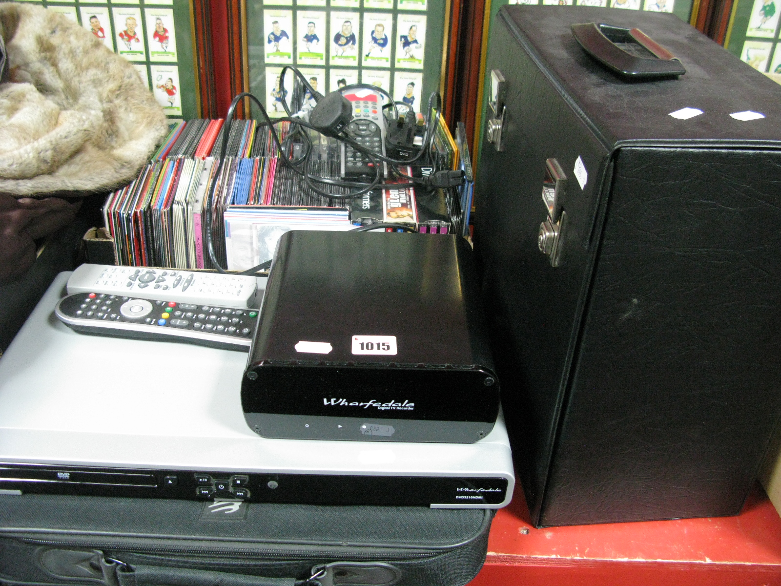 Lot 1015 - A Wharfdale Wdtr160 Digital TV Recorder, Wharfdale 3210 DVD player, DVD's, CD's, LP's in a case,
