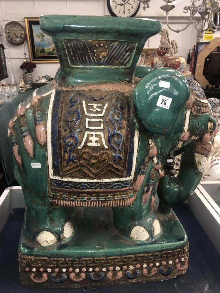 Lot 25 - A porcelain elephant